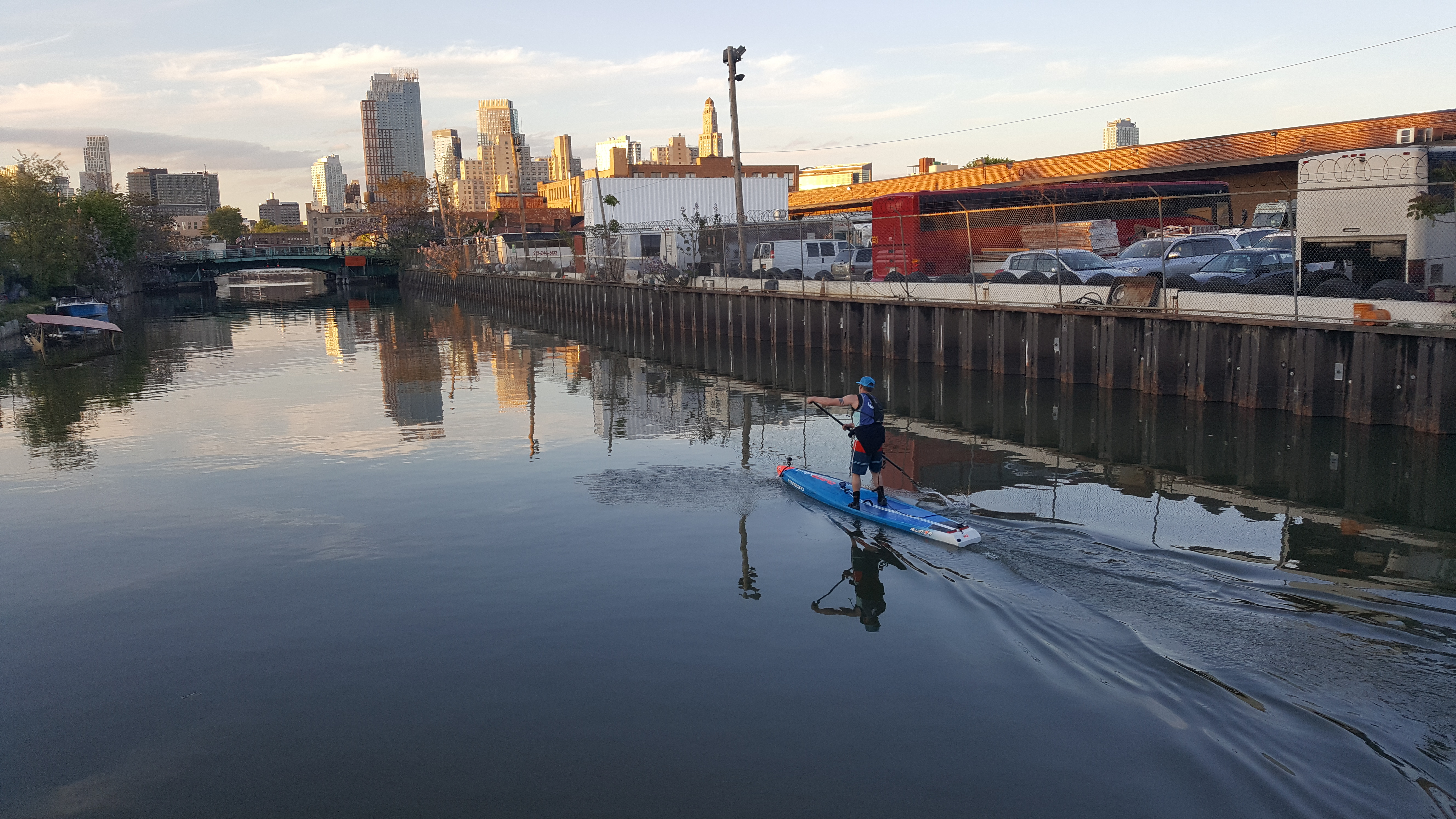 Stand Up Paddle-boarder (SUP) Recreating on Gowanus Canal